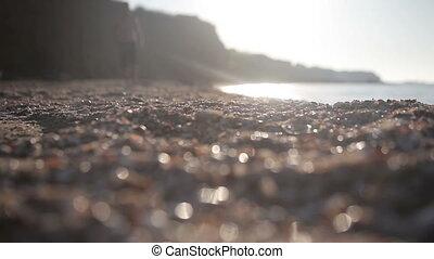 A man walks along the seashore. Full HD