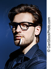 smoking man - Smoking young man. Handsome young man...