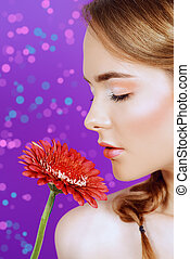smell the flower - Spa girl. Close-up portrait of a...
