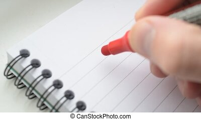Writing I LOVE YOU U with red marker in notepad - Close up...