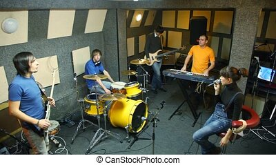 musical group of five persons in studio