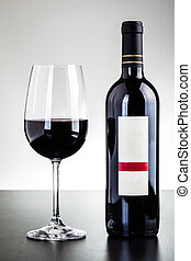 Red wine mockup - a blank labeled bottle of wine and a glass...