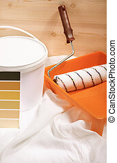 home decorating - conceptual photo with paint and roller,...