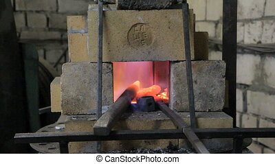 Burning fire and billet in the kiln, in blacksmith shop
