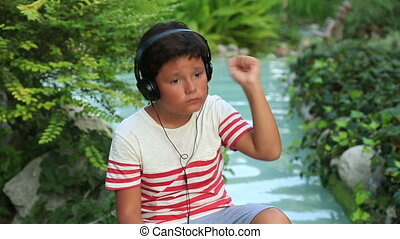 Happy child listening to music - Young child with headphone...