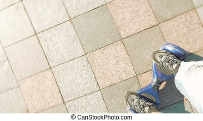 Riding electric hoverboard self balancing scooter - Man is...