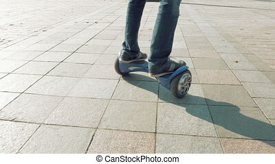 Riding hoverboard or self balancing gyro scooter - Man is...