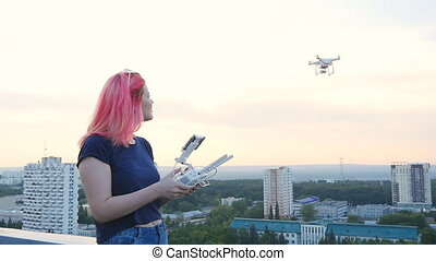 drone flying at sunset - Girl controll drone flying at...