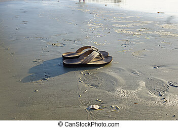 Sandals - Worn out sandals on the beach