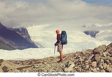 Hiker on glacier - Hike in Wrangell-St. Elias National Park,...