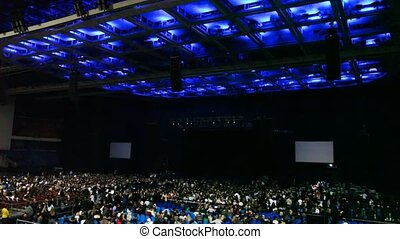 review of concert hall with people from chairs to ceiling