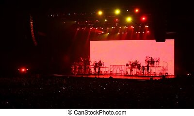people in concert hall look show with singers