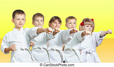 Five little athletes hits a punch arm on a yellow background