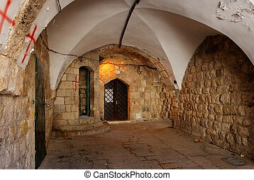 Ancient arched passage in Jerusalem Old City near the Church...