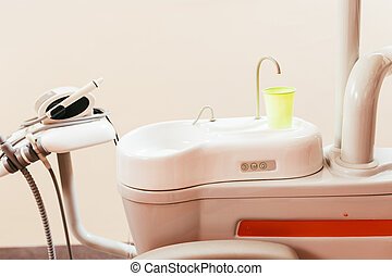 Dental chair components: ceramic spittoon, water filler and...