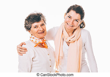 Smiling senior mother with adult daughter