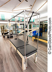 Cadillac - Pilates equipment indoors. Cadillac close-up.
