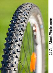 Bike wheel - Close-up of a bike wheel on green background