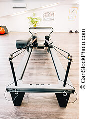 Universal reformer - pilates equipment's close-up ready to...