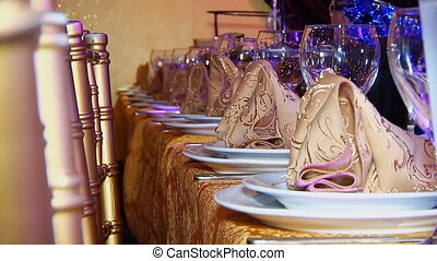 Luxury banquet table setting at restaurant. Blurred...