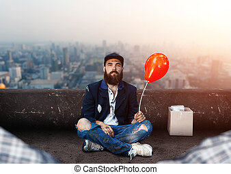 Vagrant with ballon sitting on the roof