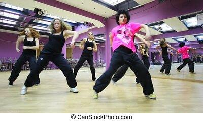 Girls dance in mirror dancing room