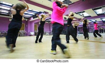Girls dance in violet dancing room