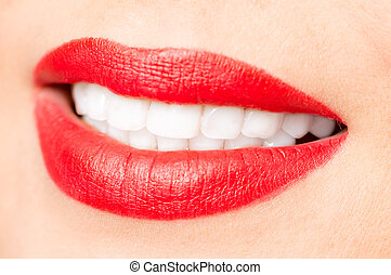 Smiling female red lips and healthy white teeth closeup shot...