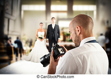 Professional photographer in a wedding - Photographer looks...