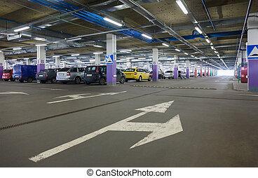Subterranean parking lot - A subterranean car park in a...
