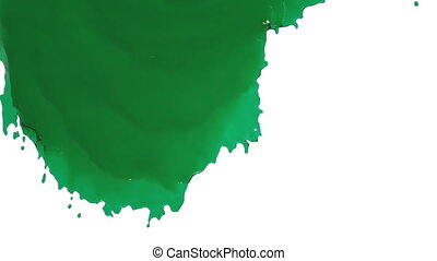 green paint flowing down slowly. Liquid oil - close-up view...