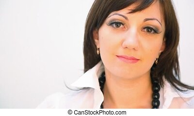 portrait of young woman dressed white blouse against white...