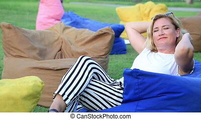 Happy woman relaxing under the sun - Pensive relaxed woman...