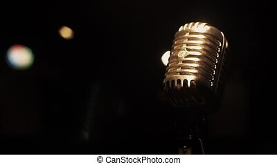 Concert metal microphone stay on stage in empty retro club. Spotlights.