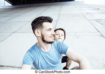 mature father with his son under the bridge having fun...