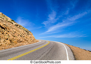 Highway Curve to the Sky - Mountain highway that seems to...