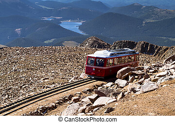 Pikes Peak Cog Railway car traveling doen from top of Pikes...