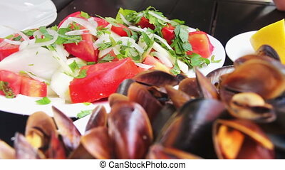 Seafood Mussels on a Plate in a Cafe - Prepared mussels...
