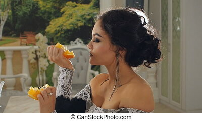 Girl eating messy orange