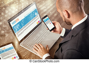Corporate website on devices - Businessman sitting at desk...