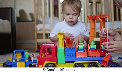 the children plays with the toys in the playroom - the...