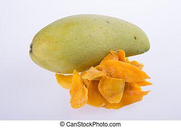 mango dry or dried mango slices on background. - mango dry...