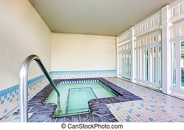 Interior of a swimming pool with tile flooring - Interior of...