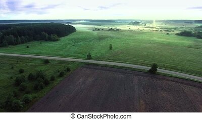 misty fields in morning birds eye view - misty fields in...