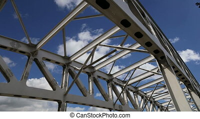 metal structure of the bridge on a background of sky