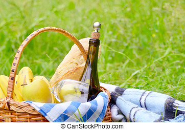 Picnic basket and blanket - Picnic basket with fruits wine...