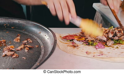 Chef Preparing Shawarma - Hand wrapping traditional shawarma...
