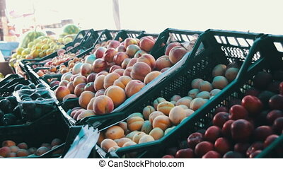 Woman Selecting Fruit on Showcase At Street Market - Farm...