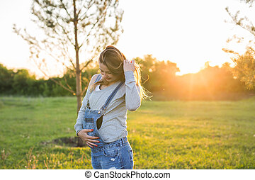 young happy pregnant woman in nature