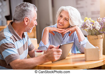 Cheerful senior couple talking - Pleasant day. Cheerful...